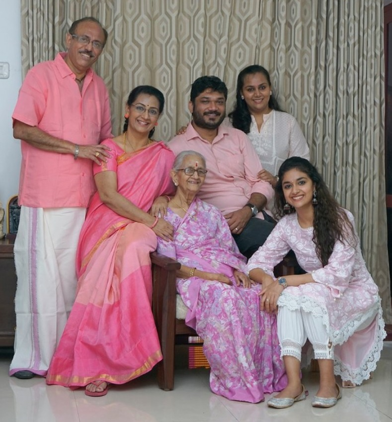 Keerthy Suresh with Cute and Chubby Cheeks Smile along with her Lovely Family