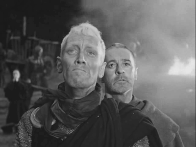 Crusading Knight Antonius Block (Max von Sydow) and Squire Jons (Gunnar Bjornstrand) witness immolation of an innocent girl