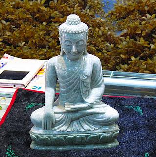 white jade Buddha statue sitting at Bogyoke Market Yangon