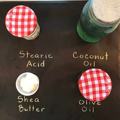lye shea butter stearic acid and olive oil in jars