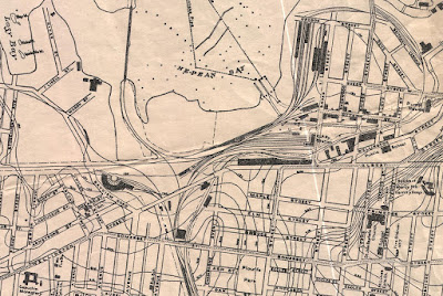 Section of a map with extents Cambirdge Street (East), Eccles, Oak, Laurel Streets (South), Pinhey Street, Stonehurst Ave, Lazy Bay (West), Oregon Street (North). Topographic lines show the rise from Nepean Bay in the Ottawa River to local high points at Champagne and Somerset, down to Preston Street, and back up with a steep hill around Lorne Avenue and Primrose (Nanny Goat Hill). Some major industrial and institutional buildings are drawn in, such as the House of Mercy Maternity Hospital (now St. Luke's Hospital), St. Jean Baptiste Church (now Dominican Colege), Wellington Street publich School (between Bridge and Hill, south side), and various industrial buildings on the Flats. Rail lines are also drawn in though they are difficult to tell from the topographic and street lines. Streetcar tracks are also shown, such as along Somerset through to Wellington, and from Somerset and Preston up to Preston and Albert and east along Albert, and from the Ottawa River down Bridge Street to Queen Street W east over Pooley's Bridge.