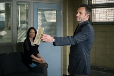 Jonny Lee Miller as Sherlock Holmes and Lucy Liu as Joan Watson in CBS Elementary Season 2 Episode 9 On the Line