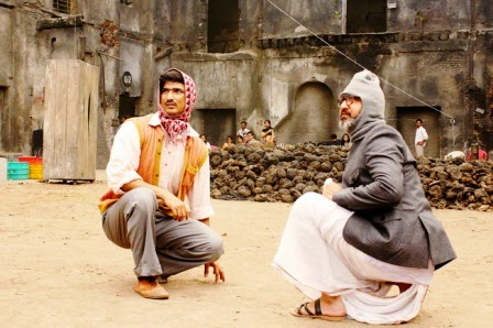 Sushant Singh Rajput as Byomkesh Bakshy, Neeraj Nabi as Dr, Guha, in Detective Byomkesh Bakshy! (2015), directed by Dibankar Banerjee