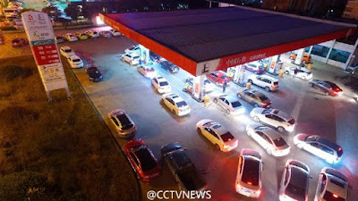 Vehicles were lining up at gas stations across China on Wednesday evening