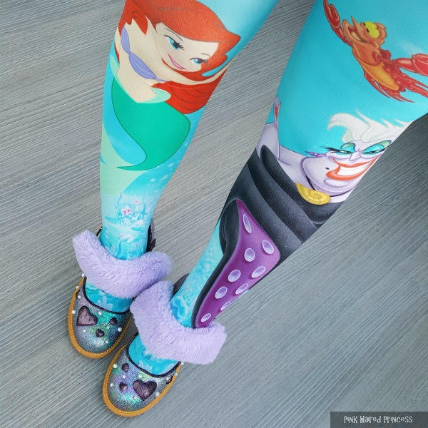 legs standing wearing the little mermaid tights with purple shoes