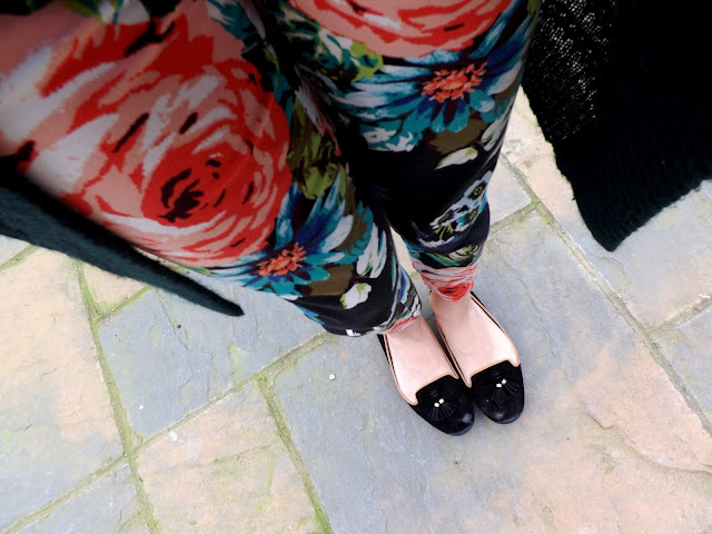 Floral trousers and black pumps