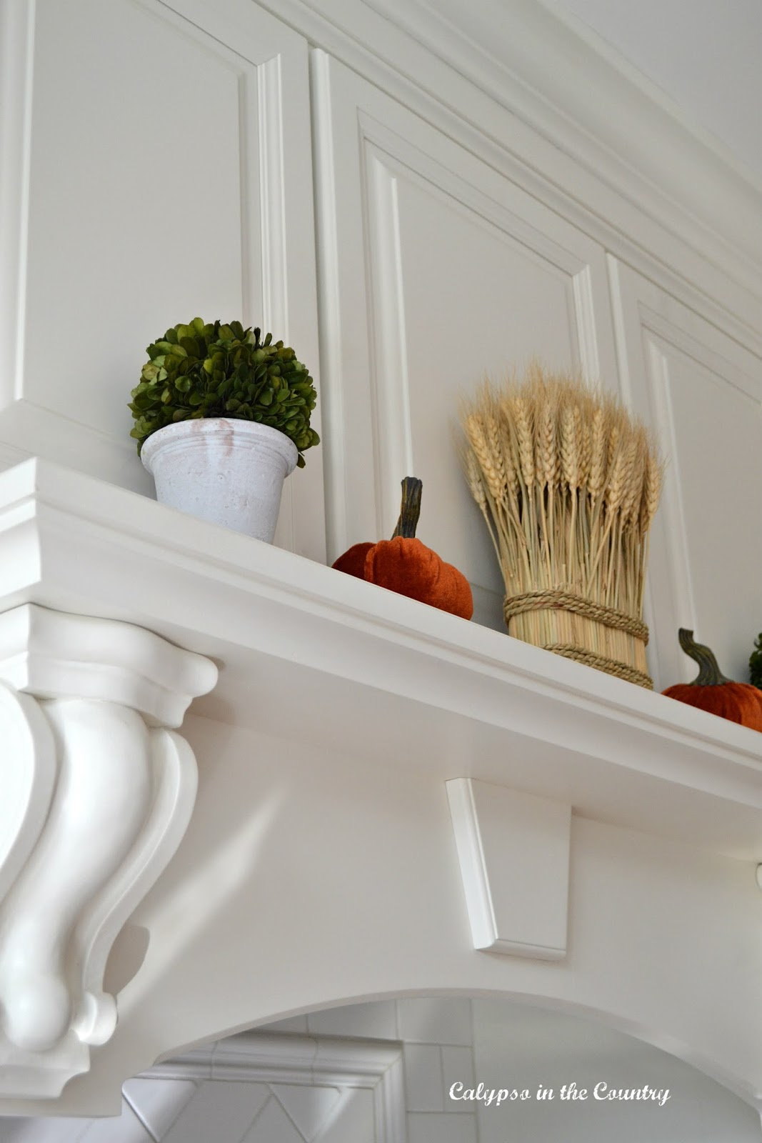 White Stove Mantel Decorated for Fall
