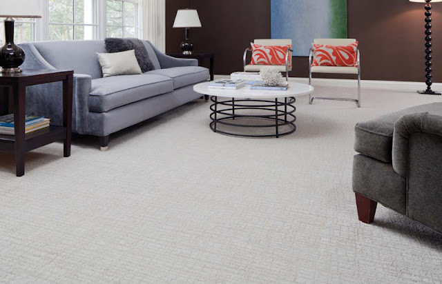 A white carpet with a subtle pattern adds a touch of interest and beauty