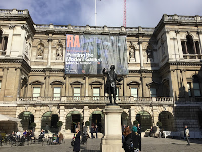 Pic of courtyard of the Royal Academy of Arts looking towards the huge Painting the Modern Garden exhibition banner on frontage