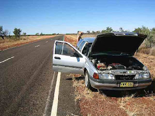 Person-lost-in-broken-down-car-in-bush
