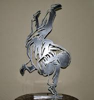 https://www.etsy.com/fr/listing/543416283/silhouette-de-judokas-en-metal-decoupe?ref=related-6