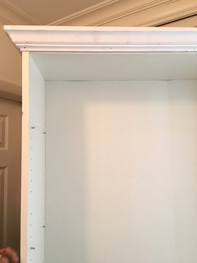 We added crown molding to the top of this Ikea Billy Bookcase to give it an elegant and fresh look. Add a coat of white paint and that's a wrap for this Ikea Billy Bookcase Hack.