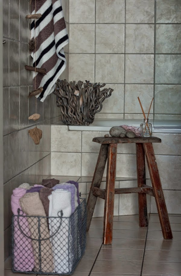 Tiled Bathroom and wire basket towel storage