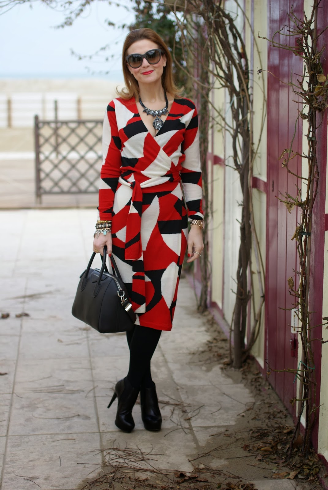 73d5dc46e28f Diane Von Furstenberg wrap dress Givenchy Antigona bag Roberto Botticelli  ankle boots