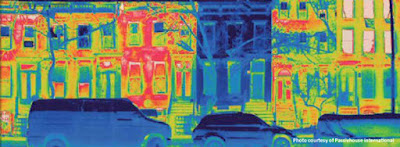 Thermal image showing how a Passivhaus refurbishment/makeover of a terraced home means it loses no heat compared to its neighbours.