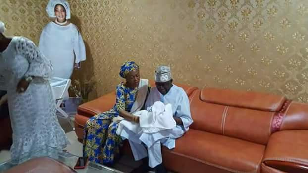 Photos: APC National leader, Bola Tinubu cradles his new grandson born through surrogacy