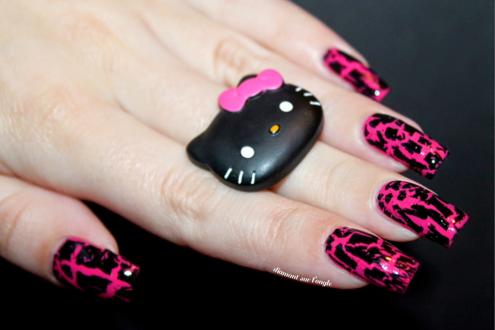 black and pink nail art done with a black shatter nail polish