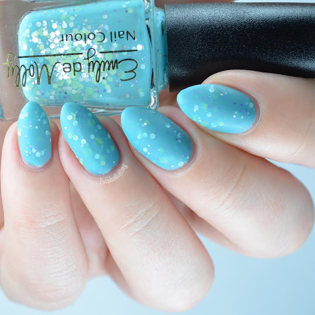 light blue nail polish with glitter with matte top coat