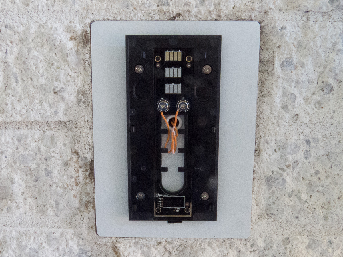 Install the adapter plate, and connect the existing doorbell switch wires  to the two contacts in the center of the plate.