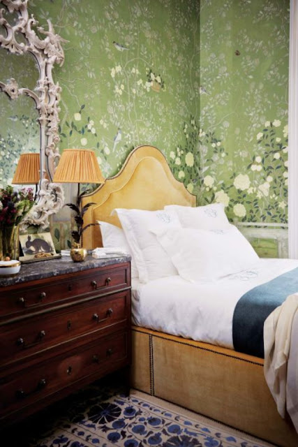 Channeling Pantone's Color of 2017 withTemple Newsam Green and Chinese Chippendale mirror, both of De Gournay; Lamp, Porta Romana; Bedding, of Fermoie, and in the dresser, golden apple, by Nicky Haslam.