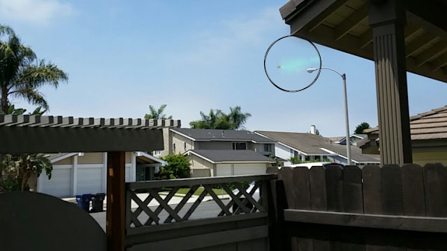 Is this UFO spraying chemicals over a neighborhood in California.