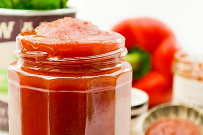 A jar of red pepper and sweet chilli sauce