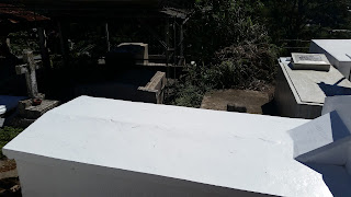 Fresh painted grave with white color