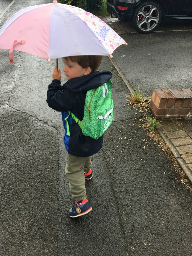 Our-Weekly-Journal-17th-July-2017-Knights-and-Sleepovers-toddler-with-umbrella