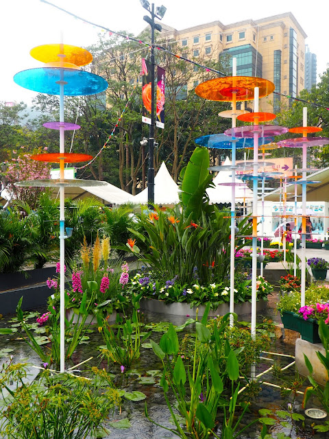 Pond with coloured glass discs - floral art installation at Hong Kong Flower Festival 2017