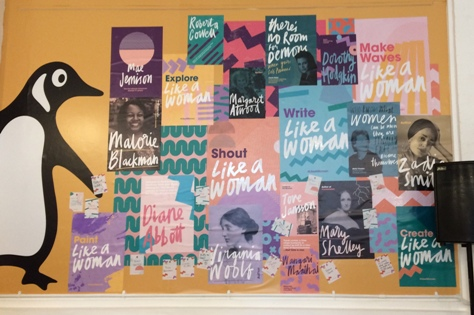 Photo of back wall of the Like A Woman Bookshop, showing inspirational posters