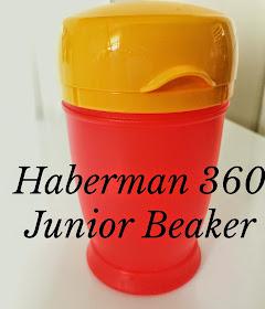 red and yellow child beaker