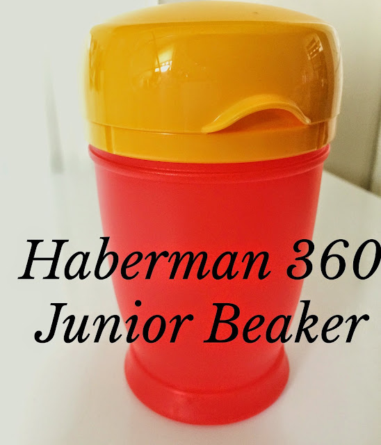red and yellow child beaker