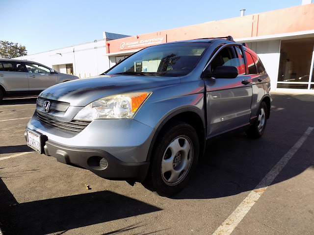 Honda CR-V before auto body repairs at Almost Everything Auto Body.