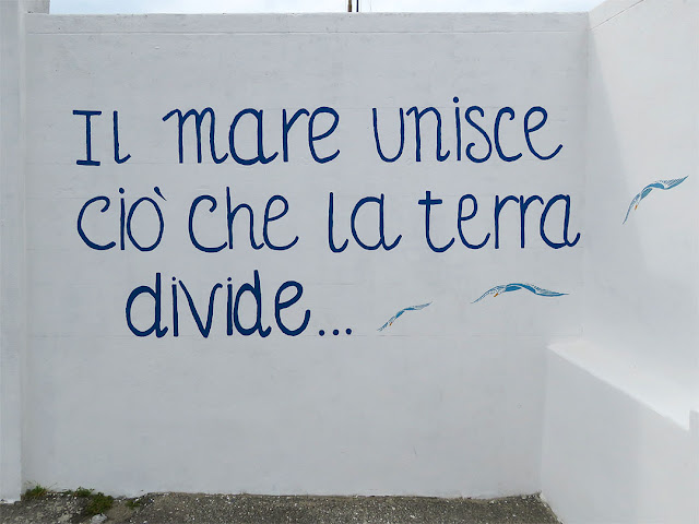 What the land divides the sea unites, Via del Molo Mediceo, Livorno