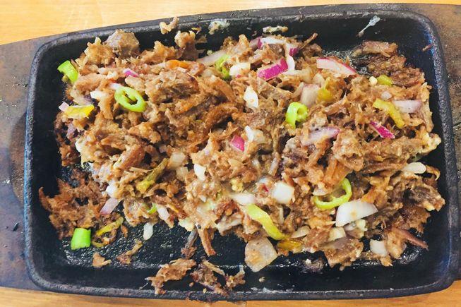 Kuya J restaurant pork sisig