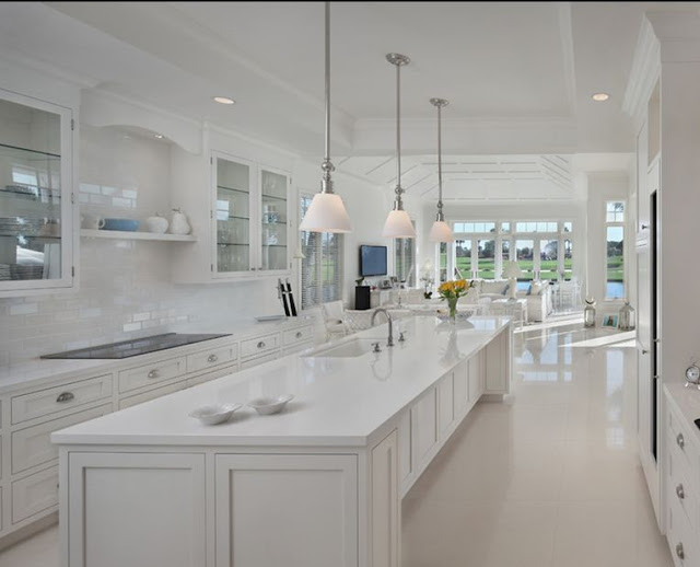 all white kitchen white floors