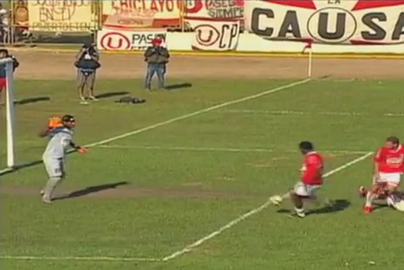 Unión Comercio player Renzo Reaños scores an own goal against Universitario