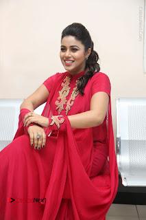 Actress Poorna Latest Stills in Red Dress at Rakshasi First Look Launch  0238.JPG