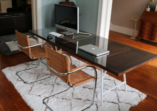 You might have already guessed (or read about it in past posts), but we  made the desk ourselves out of an antique door, custom glass top and white  Ikea ...