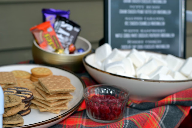 backyard gourmet s'mores bar with charcoal BBQ grill