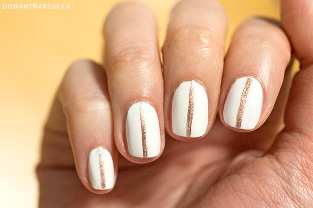 Rose gold stripe nail art on white