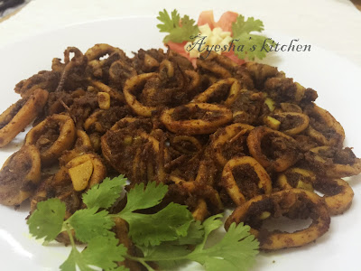 Squid fry or fried calamari recipe with onion and tomato seafood recipes special seafood dinner kerala style kanava fry
