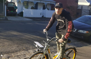 A boy riding an oBike