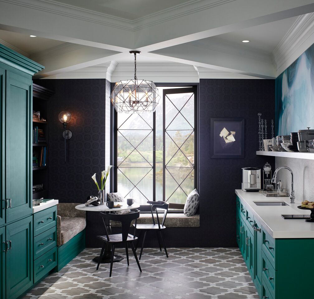 Teal painted kitchen cabinets and black wall in Kohler kitchen with banquette