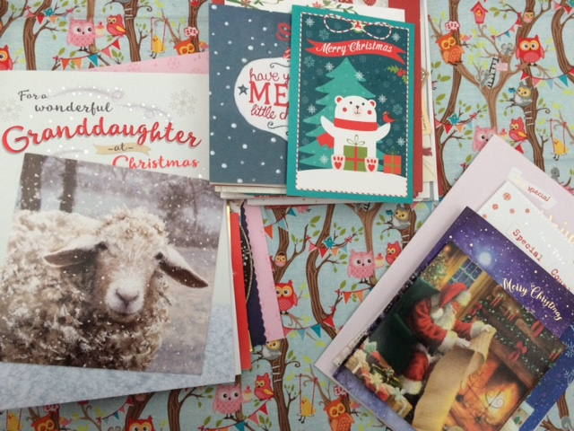 Christmas cards sorted into three piles