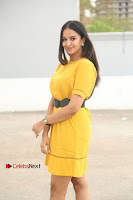 Actress Poojitha Stills in Yellow Short Dress at Darshakudu Movie Teaser Launch .COM 0055.JPG