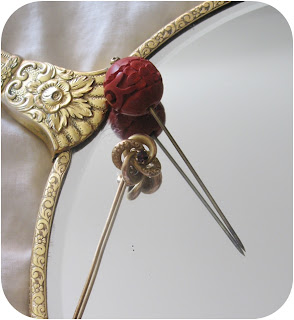 vintage cinnabar carved hat pin