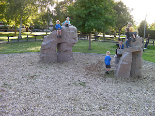 children on climbing rocks in park