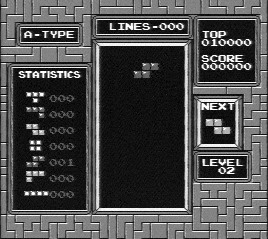 [Image: Black-and-white screen capture of NES Tetris being played.]
