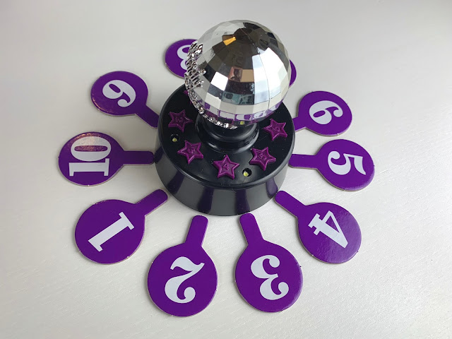 The Strictly game glitter ball speaker and scoring paddles for the live dance off